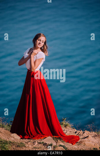 Beautiful girl dressed in white and red dress - Stock Image