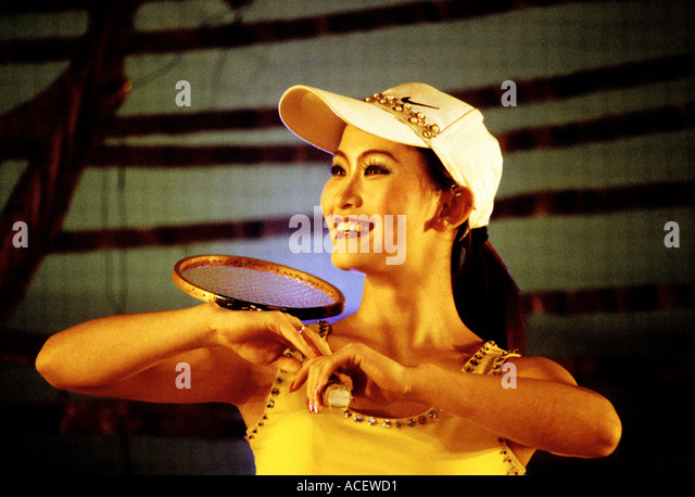 Shanghai China Model with badminton racket on stage at the Shanghai Acrobatics Performance  - Stock Image