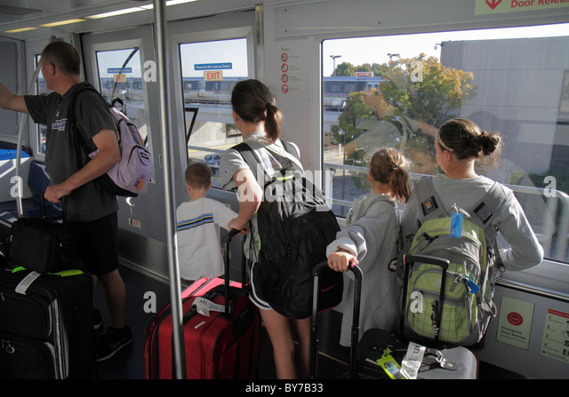 Atlanta Georgia Hartsfield-Jackson Atlanta International Airport aviation automated people mover man woman boy girl - Stock Image