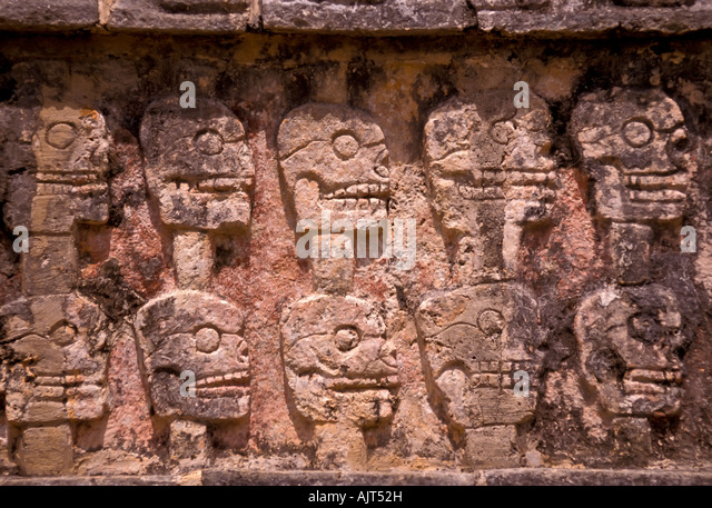 Rack of impaled human skulls called a tzompantli, Chichen Itza Maya Ruins, Yucatan, Mexico; also called a wall of - Stock Image