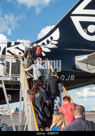 Passengers boarding Air New Zealand flight - Stock Image