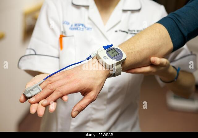 close up shot of pulse being taken - Stock Image