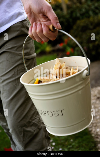 Woman taking out compost - Stock-Bilder