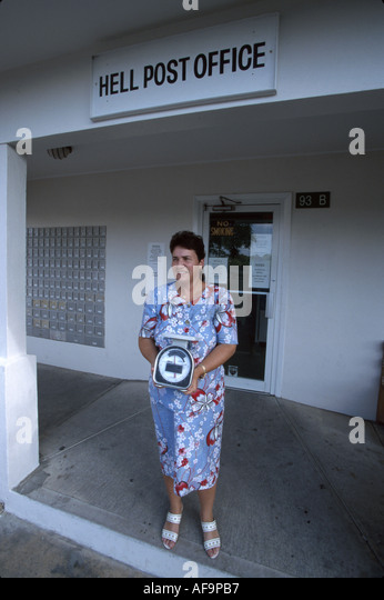Grand Cayman BWI Hell female post office clerk born and raised in Hell - Stock Image