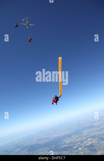 Skydivers free falling with air tube above Leutkirch, Bavaria, Germany - Stock-Bilder