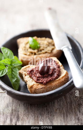 crostini with olive paste - Stock Image
