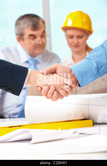 Image of customer and architect handshaking after making an agreement - Stock Image