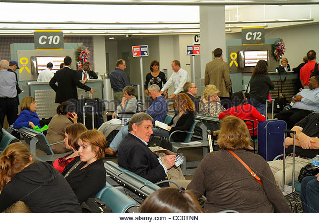 Louisiana New Orleans Louis Armstrong New Orleans International Airport MSY terminal gate area passenger waiting - Stock Image