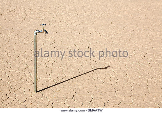 Faucet in desert landscape - Stock Image
