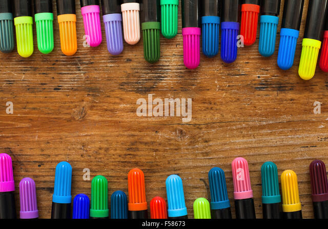 colorful markers on wooden desk, background - Stock-Bilder