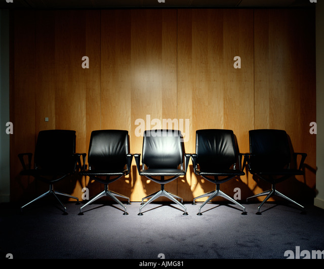 Row of empty office chairs - Stock Image
