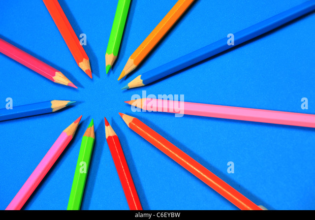 Multi-coloured pencils or crayons in a circle - Stock Image