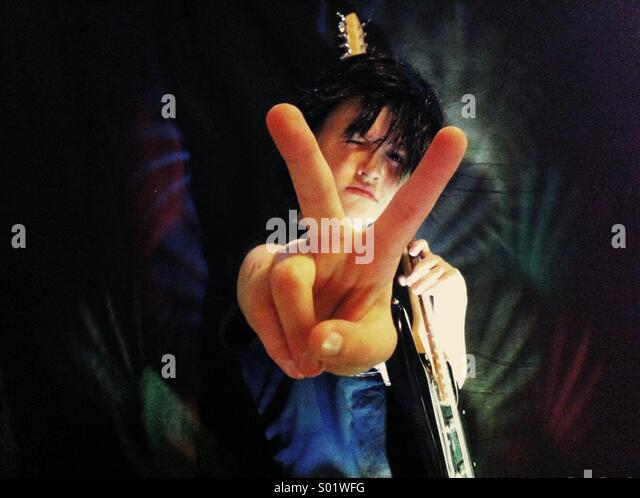 Rock star kid -peace! - Stock-Bilder