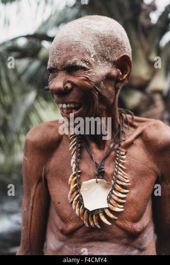 Indonesia, Irian Jaya, Standing native people. (Large format sizes available) - Stock Image