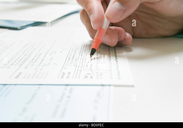 Signing a IRS tax form - Stock Image