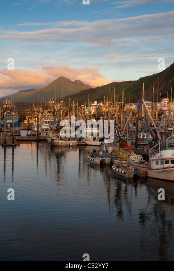 Sunrise over Saint Paul Boat Harbor with Pillar Mountain  to the right, Kodiak, Southwest Alaska, Summer - Stock Image