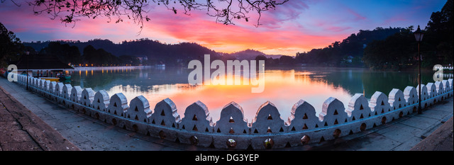 Sunrise at Kandy Lake and the Clouds Wall (Walakulu Wall), Kandy, Central Province, Sri Lanka, Asia - Stock Image