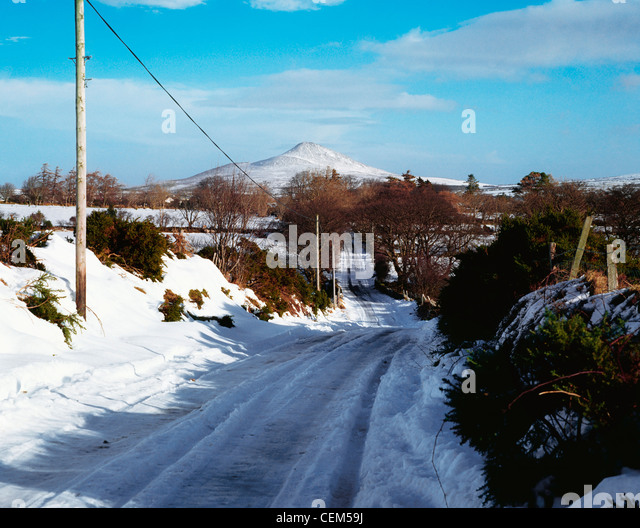 Snowy Road Near Sugarloaf Mountain, Co Wicklow, Ireland - Stock Image
