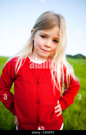 Little girl in red sweater - Stock Image