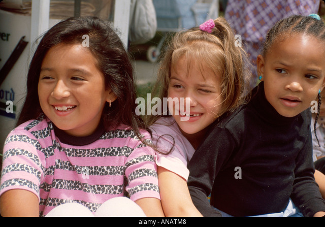 New Jersey Saddlebrook Hispanic Black girl friends watch parade - Stock Image
