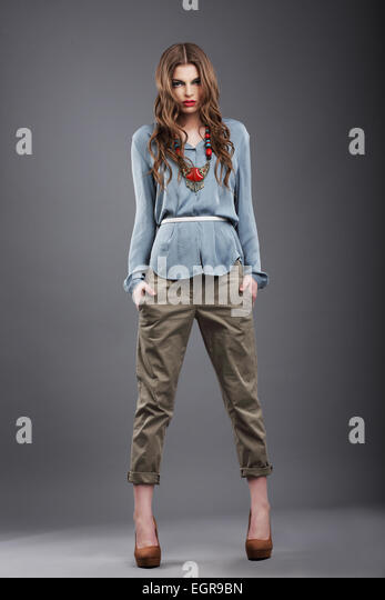 Individuality. Trendy Fashion Model in Pants - Stock Image