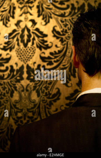Man in suit, rear view - Stock Image