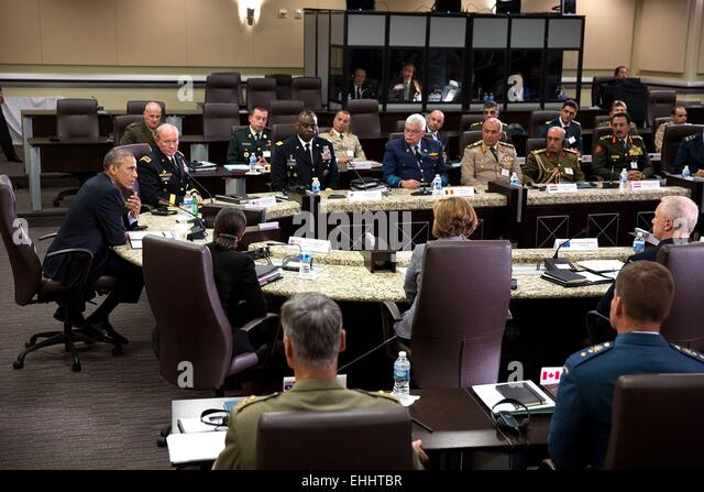 US President Barack Obama participates in a meeting with foreign chiefs of defense to discuss the coalition efforts - Stock Image