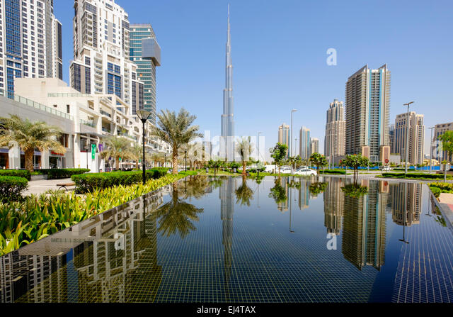 Burj Khalifa tower reflected in pond in Dubai United Arab Emirates - Stock Image