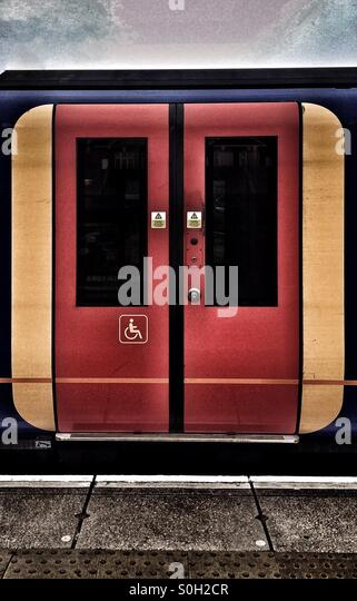 Disabled sign on the sliding doors of a Southwest Trains carriage - Stock Image