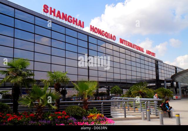 Shanghai China Changning District Hongqiao Airport Terminal 2 SHA sign English language outside exterior - Stock Image