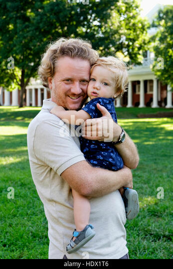 Caucasian father holding baby son outdoors - Stock Image