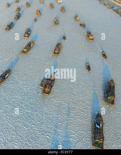 Yantai. 26th Jan, 2016. Photo taken with a drone on Jan. 26, 2016 shows fishing boats trapped in sea ice in a port - Stock Image