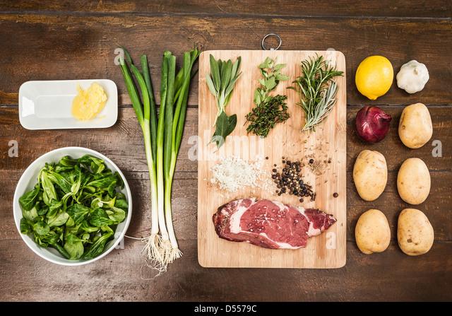 Table with ingredients and seasonings - Stock-Bilder
