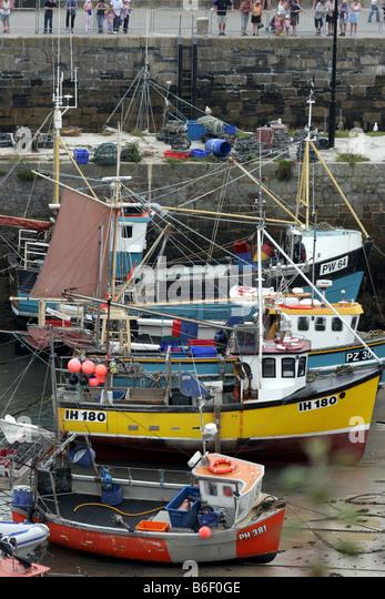 fishing boats vessels fish newquay seafaring - Stock Image