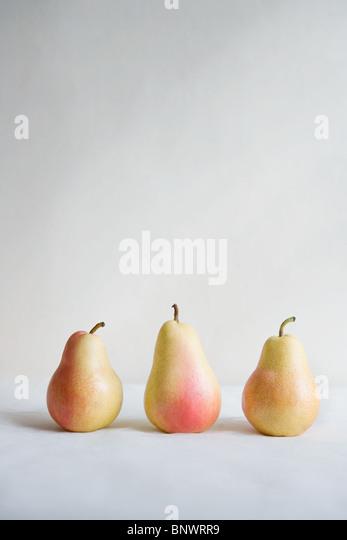 Three pears in a row - Stock-Bilder