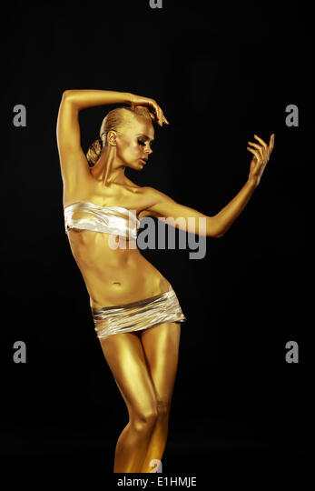 Radiance. Golden Statue. Gilded Woman's Body. Gold Bodyart - Stock Image