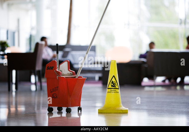 floor cleaning in hotel foyer - Stock-Bilder