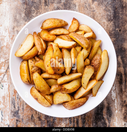 Fried potato 'country-style' on plate - Stock Image