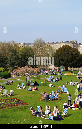 people relaxing in parade gardens, bath, england, uk - Stock Image