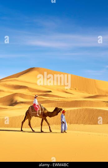 Tourist on camel ride, Erg Chebbi desert near Merzouga, Sahara, Morocco - Stock-Bilder