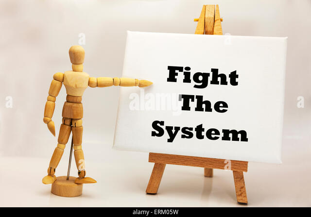 Wooden man with white board pointing at words 'fight the system' anarchy war politics revolution revolutionary - Stock Image