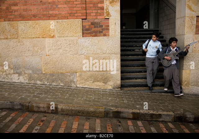 And old English style school in Bogota - boy with a guitar - Stock Image