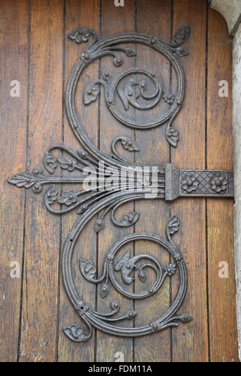 Door hinge of Eglise St Micheil near Angouleme France - Stock Image