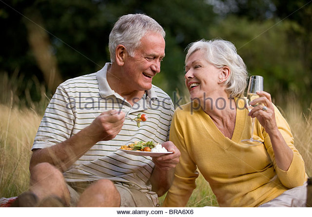 A senior couple having a picnic - Stock Image