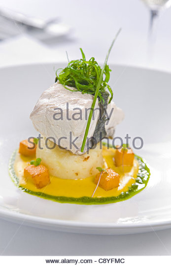 fish served with potato and sauce - Stock-Bilder