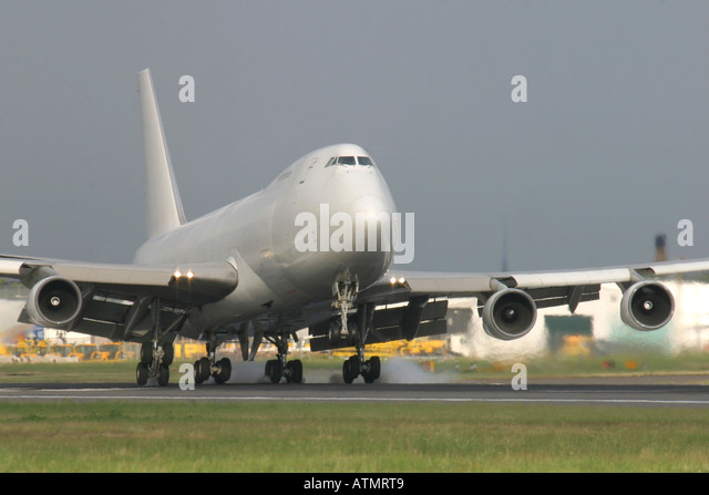 Large cargo jet touching down at an airport - Stock Image