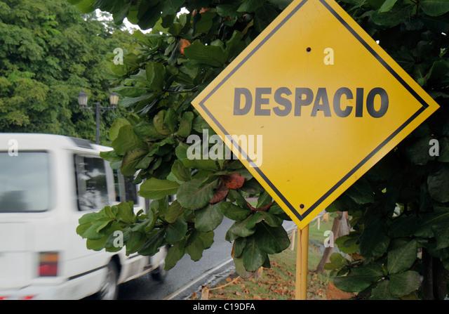 Panama Panama City Amador Causeway Calzada de Amador Bahia de Panama Panama Canal street sign warning decrease speed - Stock Image