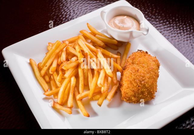 Rissole with a potato fry - Stock Image