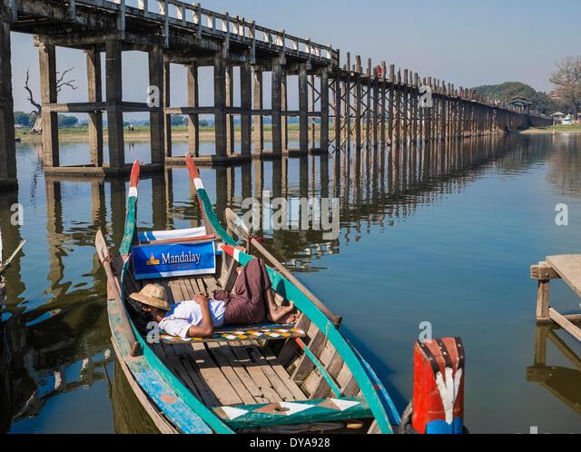 Amarapura Mandalay Myanmar Burma Asia Thaungthaman boat bridge lake longest reflection river siesta skyline sleeping - Stock-Bilder