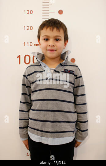 Boy measuring his height - Stock Image